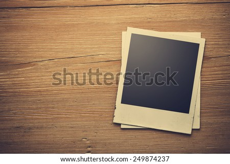 close up of an old photo on a wooden background - stock photo