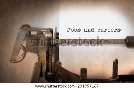 Close-up of an old typewriter with paper, selective focus, Jobs and careers - stock photo