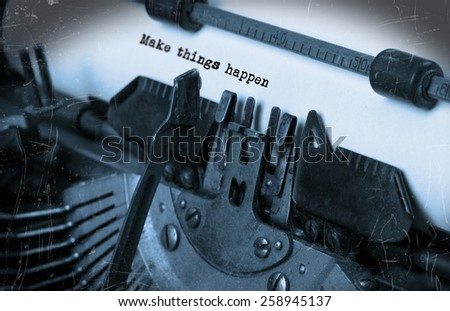 Close-up of an old typewriter with paper, selective focus, Make things happen - stock photo