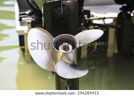 Close up of an outboard engine and propeller - stock photo