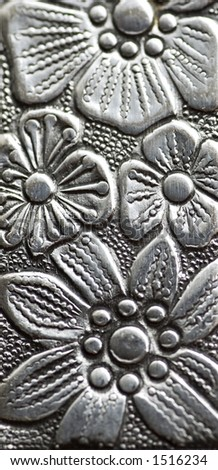 close up of an silvery engraving - stock photo