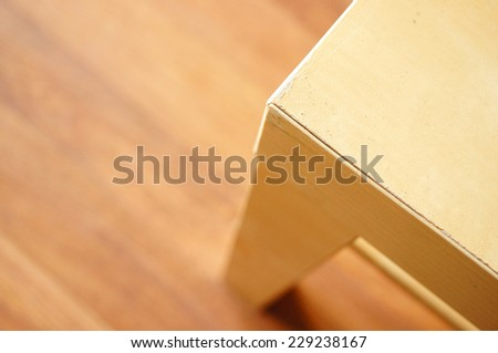 Close-up of an wooden table corner - stock photo