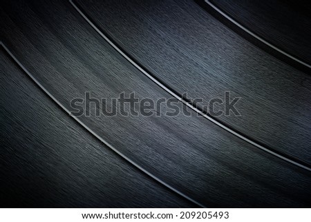 Close up of analog vinyl record surface - music background - stock photo