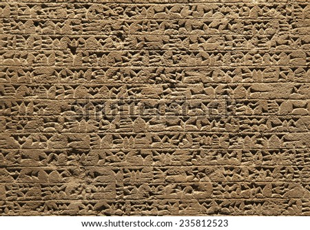 Close-up of ancient clay tablet with cuneiform writings - stock photo