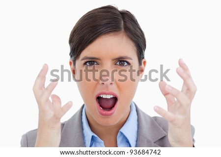 Close up of angry shouting entrepreneur against a white background - stock photo