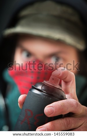 Close up of anonymous criminal pressing spray paint nozzle - stock photo