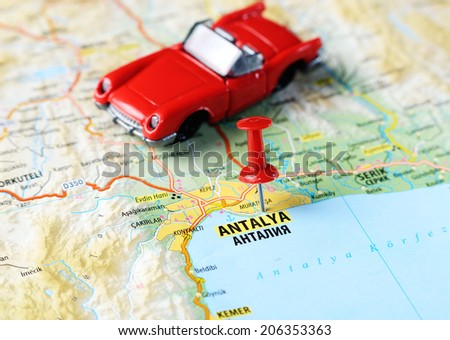Close up of  Antalia,Turkey  map with red pin  and a car  - Travel concept - stock photo
