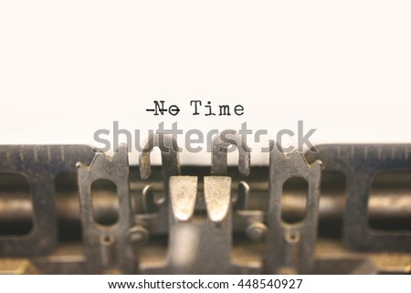 Close up of antique typewriter with text No Time but have dash on No, meaning to there is always time concept. Selective focus on message, vintage filter style.  - stock photo