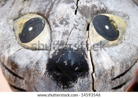 close-up of antique wooden cat face - stock photo