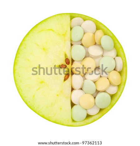Close up of apple and pills isolated - vitamin concept - stock photo
