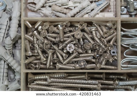 Close up of assorted steel nuts and bolts - stock photo