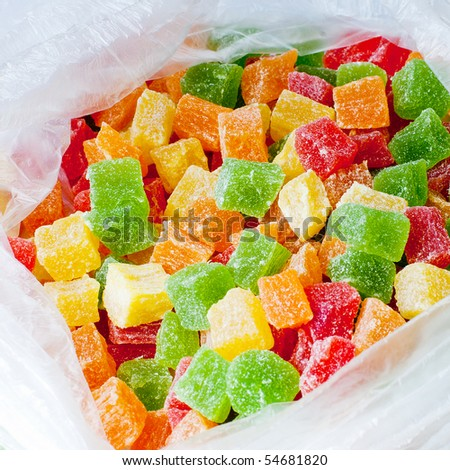 close up of assortment of colorful candy in plastic bag - stock photo