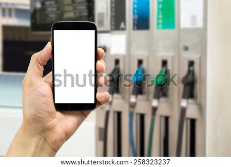 close up of at the cellphone at a gas station - stock photo