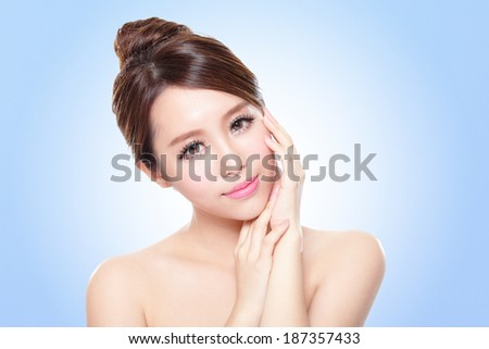 close up of attractive asian woman face with blue background - stock photo