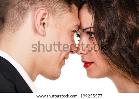 close up of attractive couple passionately in love looking into each others eyes - stock photo