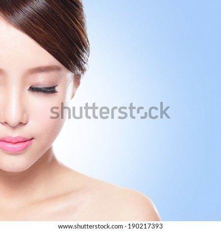 close up of attractive Skin care woman face relax closed eyes with blue background, asian beauty - stock photo