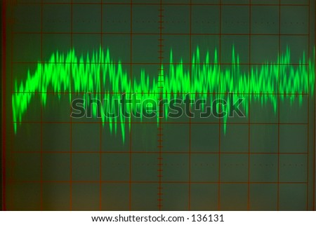Close up of audio wave form on oscilloscope screen - stock photo