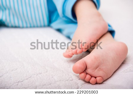 close up of baby feets on background - stock photo