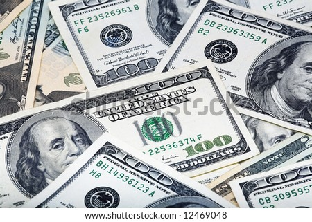 Close-up of Background of $100 dollar bills and $20 dollar bills - stock photo