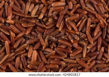 close up of background of raw red rice - stock photo