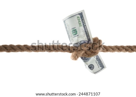 Close-up Of Banknote Tied In A Rope On White Background - stock photo