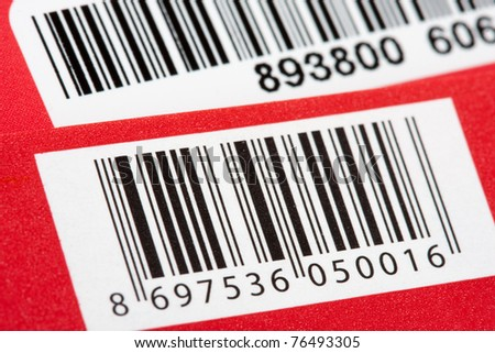 Close-up of bar codes on colorful packages - stock photo