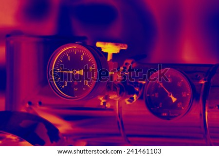 Close up of barometer in natural gas production industry - stock photo