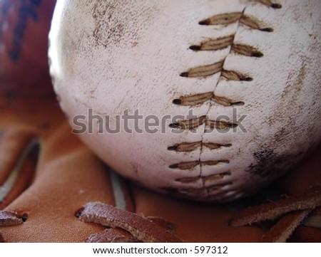 close up of baseball and ball glove - stock photo