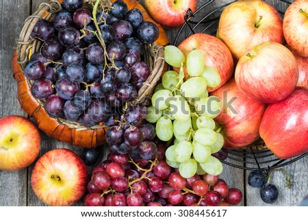 Close up of baskets with grapes and apples. - stock photo