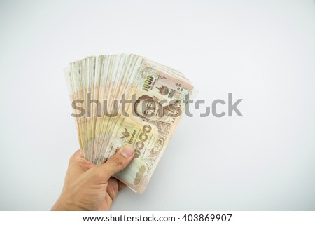 Close up of 1000 bath Thai money on hand : Thailand Currency 1000 Bath, BankNotes isolated on white background.  - stock photo