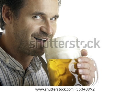 Close-up of Bavarian man which drinks out of Oktoberfest beer stein - stock photo