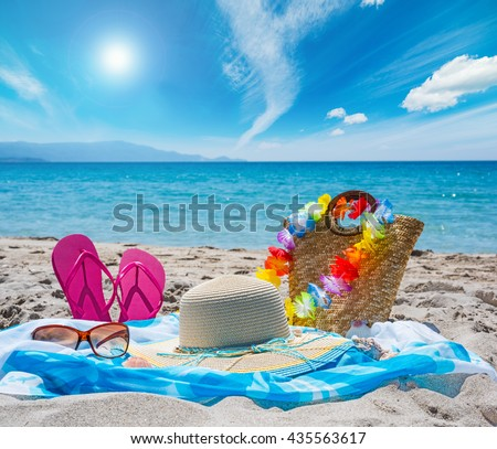 close up of beach accessories on the sand - stock photo