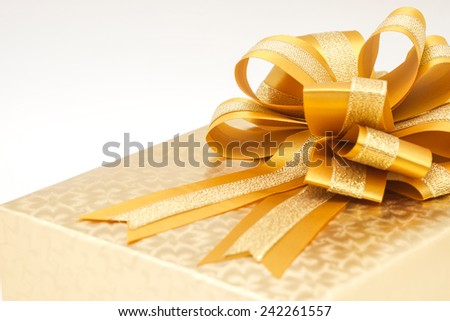 Close up of beautiful and classic golden gift box or present for special someone on love valentine's occasion  - stock photo