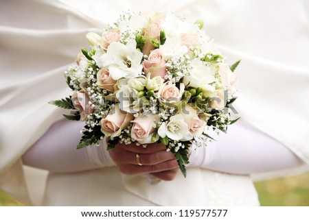 Close up of beautiful and fresh bride flowers bouquet - stock photo