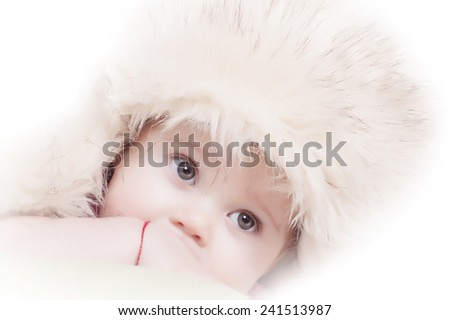 Close up of beautiful baby with winter hat - stock photo