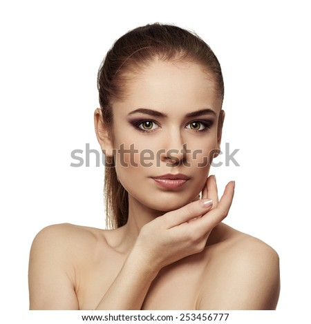 Close-up of beautiful brunette model touching her clean healthy skin. Facial lifting and skin protection concept.  - stock photo
