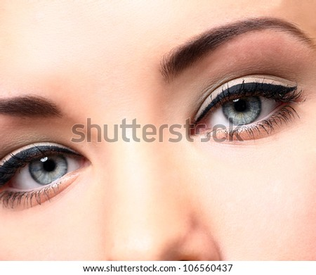Close up of beautiful eyes with makeup - stock photo