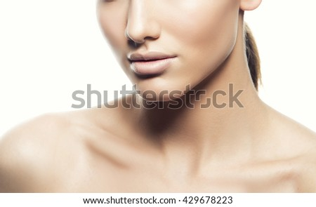 Close-up of beautiful face of young caucasian brunette woman with natural lips, nude make-up and perfect skin isolated on white. Studio portrait. Toned - stock photo