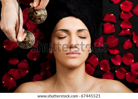 Close-up of beautiful female receiving energy sound massage at spa - stock photo