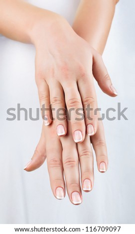 Close-up of beautiful manicured female hands - stock photo