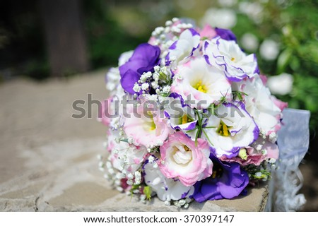 close up of beautiful wedding bouquet Bride on table. - stock photo