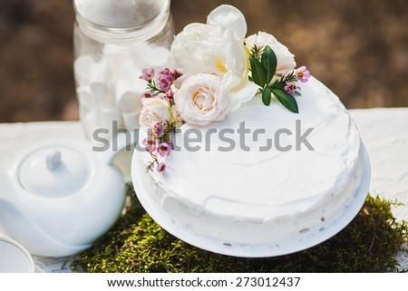 close up of beautiful white wedding cake on white table. wedding party. outdoors reception. dessert. wedding traditions. - stock photo