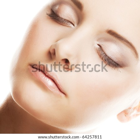 Close-up of beautiful woman face. On white background - stock photo