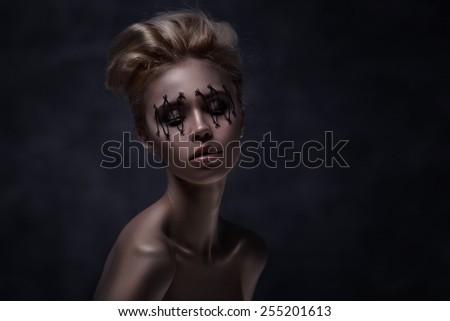 Close-up of beautiful woman face with Creative Fashion Art make up - stock photo