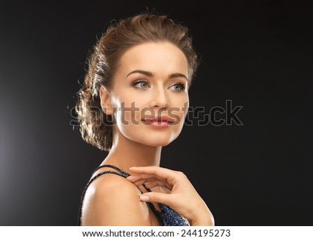 close up of beautiful woman in evening dress - stock photo