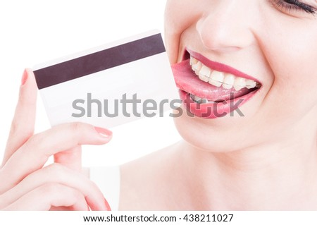 Close-up of beautiful woman licking a credit debit card isolated on white background - stock photo