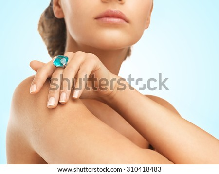 close-up of beautiful woman with cocktail ring - stock photo