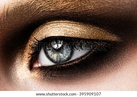 Close-up of beautiful womanish eye. Colored eyeshadows - stock photo