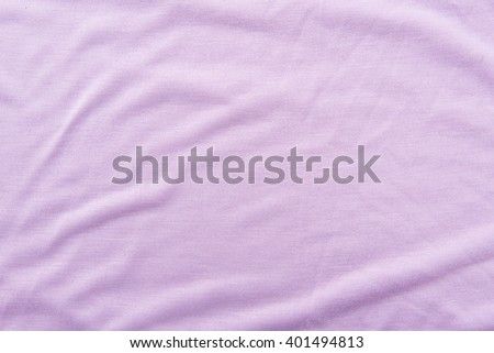 Close up of beautiful wrinkle purple fabric texture. - stock photo