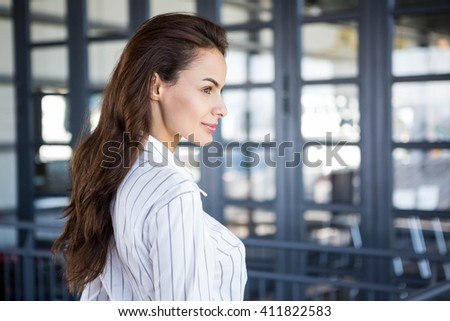 Close-up of beautiful young businesswoman in office - stock photo